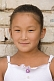 Young Mongolian girl in white dress.