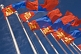 Image of Mongolian flags blow and flutter in the wind.