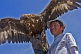 Image of Eagle and Mongolian bird-handler.
