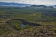 Image of A view from the extinct Khorgo Uul volcano caldera over the rich volcanic lava fields and a crater lake.