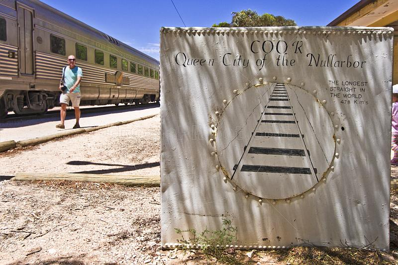 Painted water tank advertises Queen City of the Nullarbor at Cook railway station.