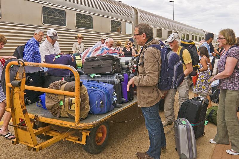 Passengers from Ghan train collect luggage at Alice Springs railroad station.