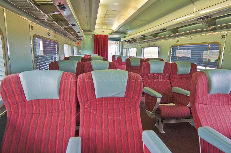 Empty red and gray Day-Nighter seats in Ghan Red Class carriage.