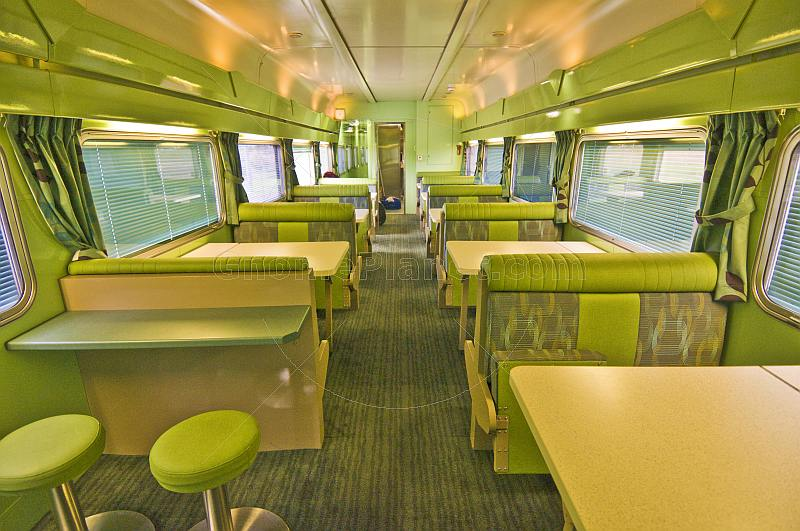 Tables and seating in the Matilda Cafe buffet car of the Ghan long distance train.