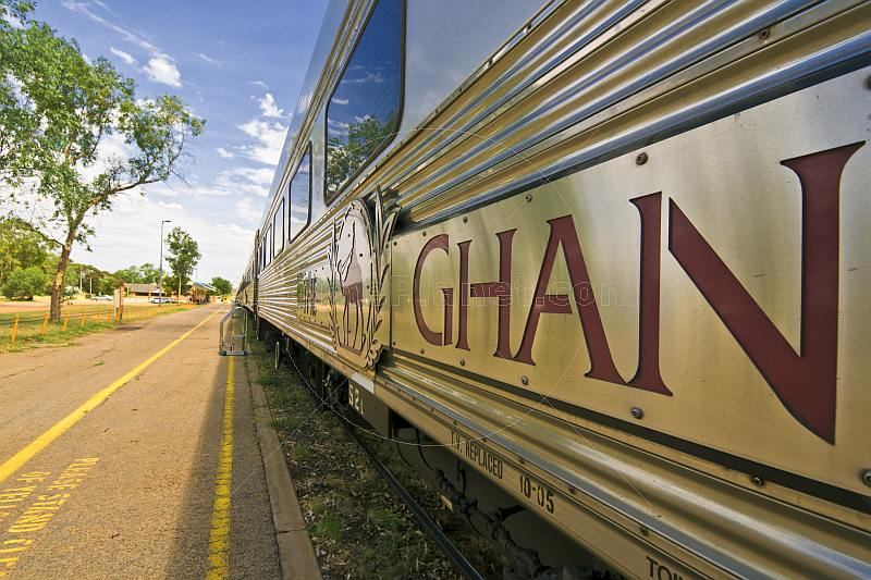 Ghan train signboard and logo on carriages at Alice Springs railway station.