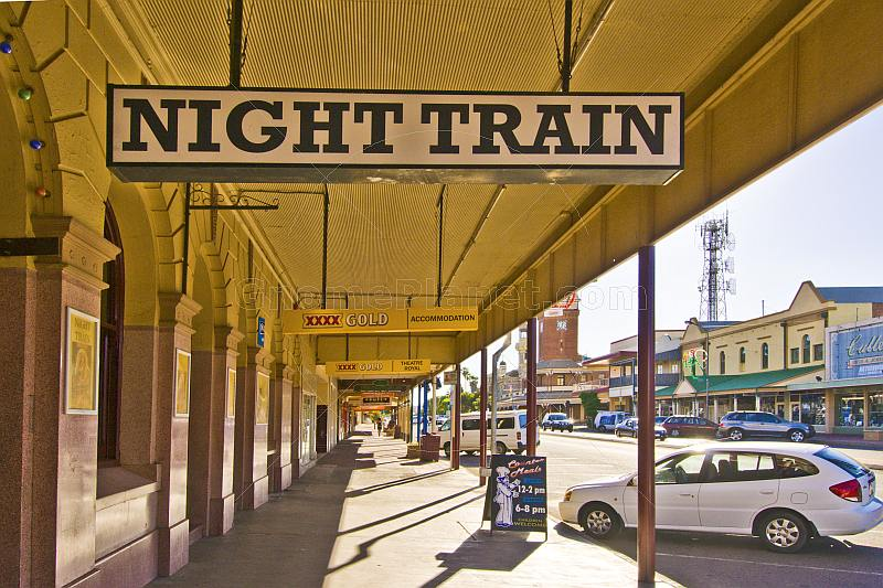 Sign for Night Train bar on deserted downtown Argent Street.