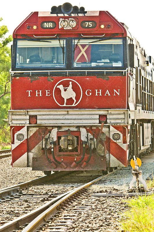 Red Ghan railway locomotive crosses the switches at Alice Springs station.