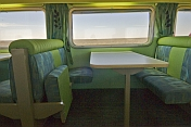 Seating and tables in the Matilda Cafe buffet car of the GSR Indian Pacific train.