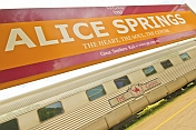 Great Southern Rail station signboard and Ghan train carriages at Alice Springs.