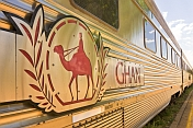 Ghan train logo on stainless steel carriages carriages at Alice Springs railway station.