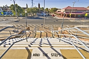 Exit stairs and railings from Broken Hill station to Crystal Street and The Mall.