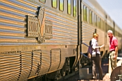 Passenger talks to crew member on 'Indian Pacific' at Cook station