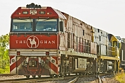 The Ghan's red locomotive clears the points at Alice Springs