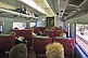 Image of Passengers and seating in Indian Pacific Red Class carriage.
