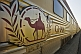 Image of Ghan train camel logo and carriages at Alice Springs railway station.