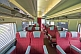 Image of Empty red and gray Day-Nighter seats in Ghan Red Class carriage.