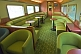 Image of Tables and seating in the Red Gum Lounge Car of the Ghan long distance train.