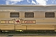 Ghan train signboard and stainless steel carriages at Alice Springs railway station.