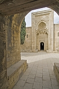Mausoleum of the Shirvan Shahs seen through an archway.