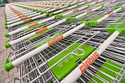 Lines of stainless steel shopping trolleys outside Globus, a modern Russian supermarket.