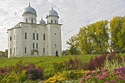 Cathedral of St George at the Yurev Monastery, set in a colourful garden of flowers.