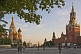 Image of Crowds wander past St. Basils Cathedral and across Red Square in the evening sunshine.
