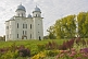 Image of Cathedral of St George at the Yurev Monastery, set in a colourful garden of flowers.