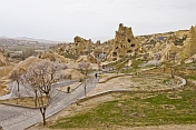 Visitors wander around the valley of rock-cut cave churches near Goreme.