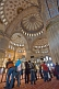 Image of Tourist group views the domed interior of the Sultan Ahmet Camii, the Blue Mosque, in Sultanahmet.