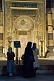 Image of Three female pilgrims view the mihrab of the Aya Sofya in Sultanahmet.