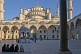 Image of Worshippers wait in the courtyard of the Ahmet Camii Blue Mosque lit by evening sunshine.