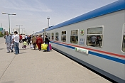 Rail travellers board the Dashogus Express at Ashgabat Station.