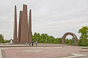 A Turkmen family makes a pilgrimage to the World War II memorial at Independence Square.