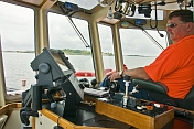 Master of the tugboat 'Liberty' guides his ship out of Boston harbor.