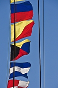 Colorful signal flags on rigging of the Russian tallship 'Kruzenshtern'.