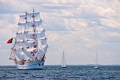 The square rigger 'Sagres' sails past two spectator yachts off the Massachusetts coast.