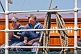 Image of Russian cadets enjoy a cigarette break by the wheelhouse of the tallship \\\\'Kruzenshtern\\\\'.