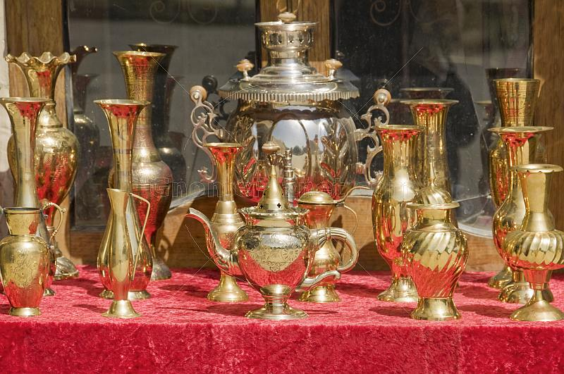 A samovar and brass jugs for sale in the bazaar.