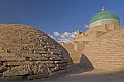 Early morning sunshine lights the brick domes of the Bathhouse of Anush-Khan.