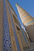 Closeup of the traditional glazed blue ceramic tiles adorning the frontage of the Minaret and Madrassah of Islam-Khodja.