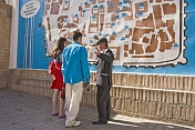 Uzbek guide tells a tourist couple the history of this fabled Silk Road city.