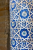 Detail of ornate blue glazed ceramic tilework on the Amin Khan Madrassah.