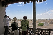 Tourists view the ancient buildings of the Khiva skyline from the roof of the Kuhna Ark.