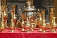 Image of A samovar and brass jugs for sale in the bazaar.