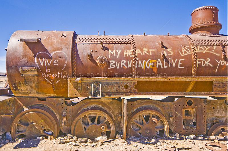 Graffiti on abandoned steam locomotive in the cemetery of steam engines.