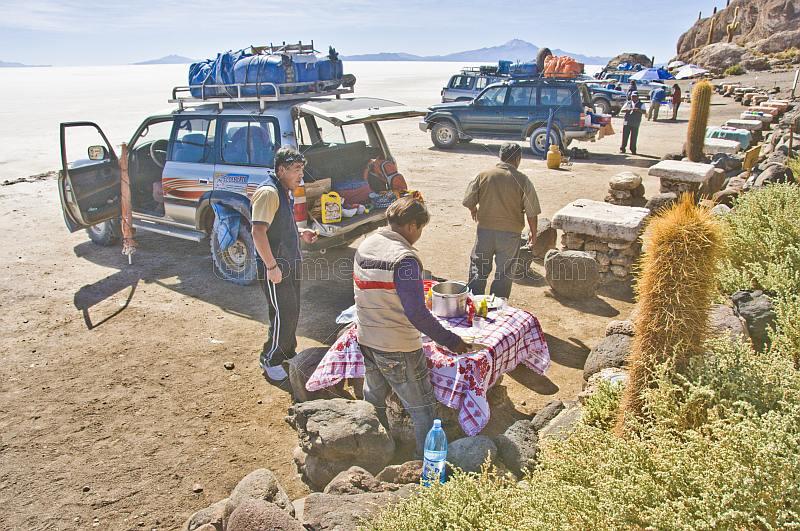 Families with 4WD cars picnicking on the Isla Pescado in the Uyuni Salt Flats.