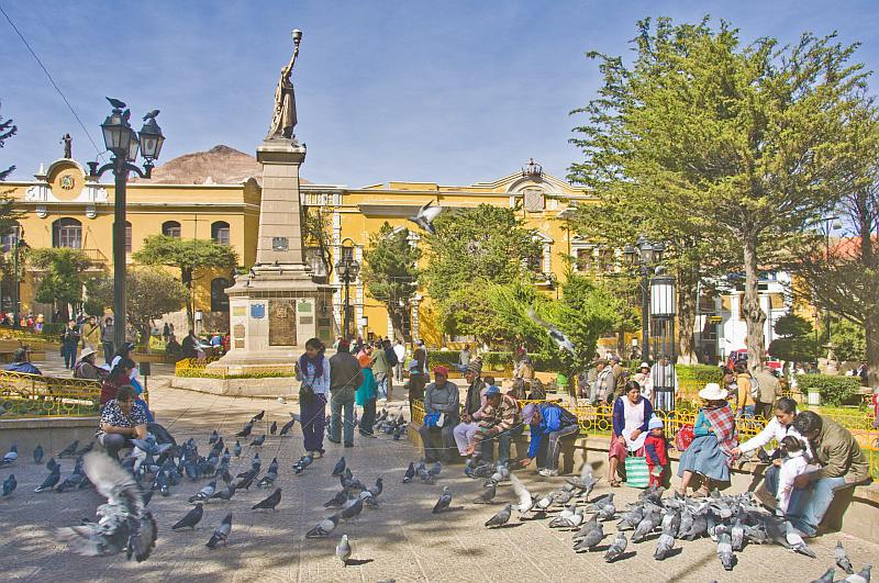 Locals feed the pigeons in the busy Plaza 10 de Noviembre.