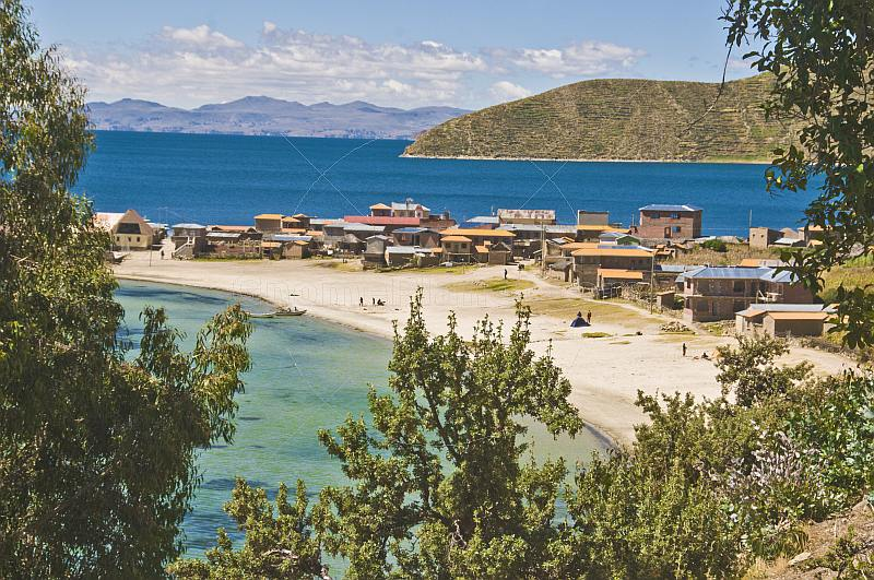 Beach houses and harbor on the Isla del Sol in Lake Titicaca.