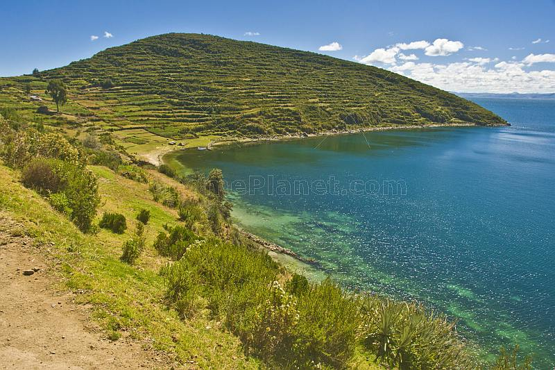 Terraced headland overlooks bay on the Isla del Sol in Lake Titicaca.