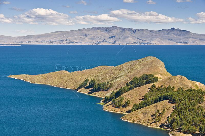 Trees and barren peninsula on the Isla del Sol in Lake Titicaca.